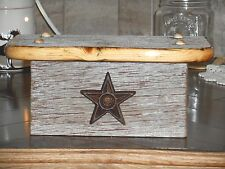 Small low cost barn wood shelf with stained edge and cast iron star
