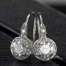 18k gold earrings made with swarovski crystal stud gp hook back
