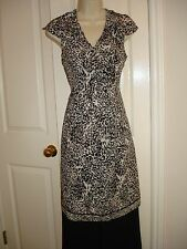 TAHARI ANIMAL PRINT PATSIE DRESS.  SIZE: 4, 6, 8, 10