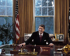 President Ronald Reagan sits at Resolute desk in Oval Office Photo Print