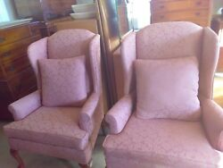 pair of pink wing chairs