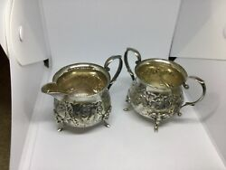 VINTAGE STERLING SILVER REPOUSSE CREAMER AND SUGAR BY BALDWIN & MILLER