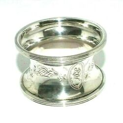 Solid silver concave style antique napkin ring with engraved design