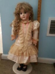 24 inch A 14 T reproduction antique doll $200.00