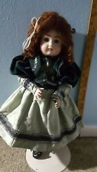 19 inch #14 reproduction antique doll $140.00