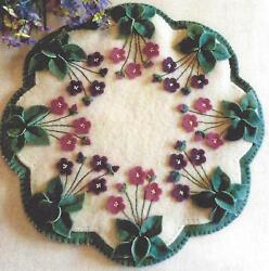 Violets in My Garden wool penny rug candle mat pattern by Cath's Pennies Designs
