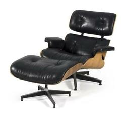 EAMES LOUNGE CHAIR AND OTTOMAN Designed by Herman Miller. Molded woo... Lot 1091