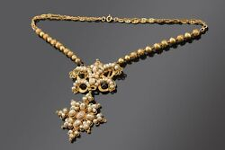 Short necklace (choker). Gold pearls. Circa late 19th century.