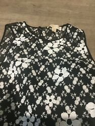 Michel Kors black netting cocktail dress with ruffle hem and white daisies size6