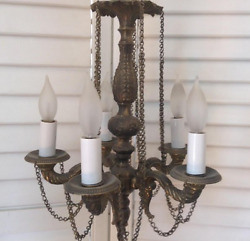 Interesting accent five arm brass chandlier with chains $495.00