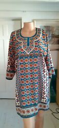Multi-coloured floral kaftanbeach cover-up with blue diamante. $3.27