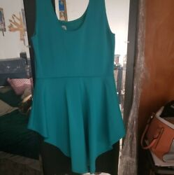 Peplum Teal and Black dresses. Size Large