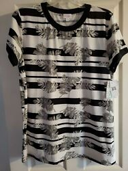 LuLaRoe 2XL CLASSY LIV TEE LEAVES ON BLACKAND WHITE. New with tags. $22.00