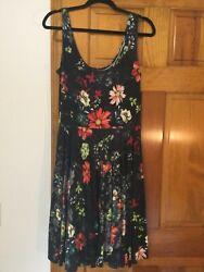 Salaam sleeveless dress black with multi color floral size large $15.00