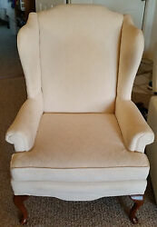 Pair of Wing Back Arm Chairs ivory needs cleaning but they are in good shape.