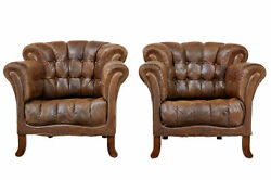 PAIR OF EARLY 20TH CENTURY LEATHER ARMCHAIRS
