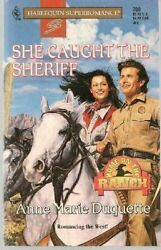 She Caught the Sheriff by Anne M. Duquette