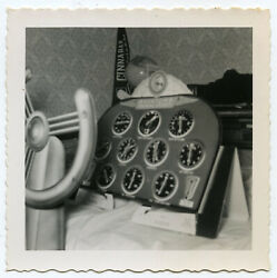 TOY AVIATOR CARDBOARD CUT OUT WHEEL DIALS ON A BED VINTAGE SNAPSHOT PHOTO