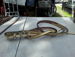 Lightly used light oil show reins with silver buckles