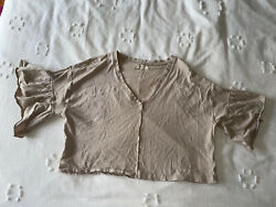 Tan urban outfitters crop top large with ruffle sleeves. $15.00