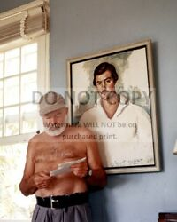 ERNEST HEMINGWAY IN FRONT OF PORTRAIT OF HIMSELF CIRCA 1953  8X10 PHOTO (AA-277) $7.98