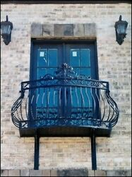 Wrought Iron Balcony with stand off platform.