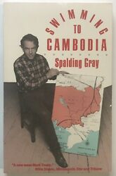 Spalding Gray Swimming to Cambodia SIGNED 1986 Softcover Second Printing $50.00