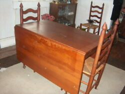 CHERRY DROPE LEAF TABLE. ANTIQUE. COMES WITH 6 STEPBACK CHAIRS. 2 CAPTAINS