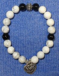 Multi-color Skull Head Stretch Bead Bracelet with Silver accents