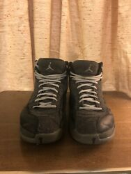 Air Jordan 12 mens size 10.5 black and grey fair condition. $50.00
