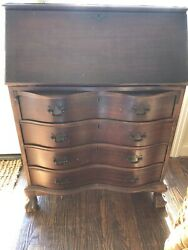 Mahogany Antique desk with clawed feet secret drawers. $275.00