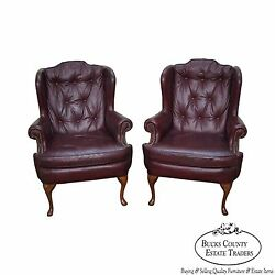Oxblood Leather Pair of Tufted Chesterfield Queen Anne Wing Chairs