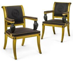 A PAIR OF REGENCY GILTWOOD AND EBONIZED ARMCHAIRS IN THE MANNER OF THOMAS HOP...