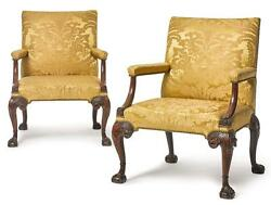 A PAIR OF GEORGE II WALNUT LIBRARY ARMCHAIRS