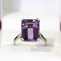 Fabulous Emerald cut 10ct Amethyst cocktail ring set in 14ct gold.