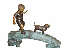 Kid with dog walking on a log Bronze Statue -  Size: 57