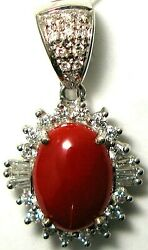 Ladies 14k-w oval Red Coral with round and TBaguette diamond pendent with enhan