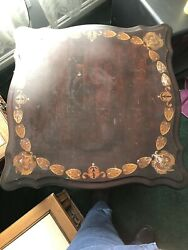 Antique table $6.08