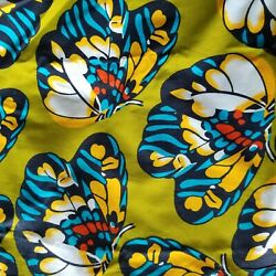 Large Scale Butterflies on Olive Unglazed African Wax Print Cotton $14.00
