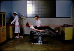 1950s Exam room Solemn doctor tells sexy patient she has cancer slide s674