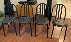 Set of 4 Mallett-Stevens chairs--black enameled steel with leather seat cushions