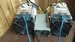 A pair of Bitmain Antminer Z9 Mini ASIC Miners with one Bitmain PSU.