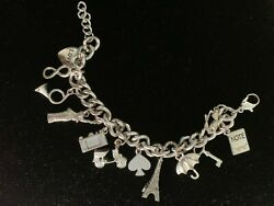 VINTAGE STERLING SILVER 10 CHARMS HEART TRUMPET EIFFEL TOWER HEAVY BRACELET