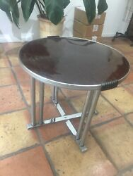 Vintage fold up table with tortoiseshell top and chrome legs. Mid century modern $30.00