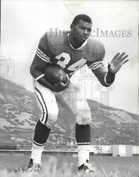 1966 Press Photo Football player Lee White in a football stance for photo $13.99