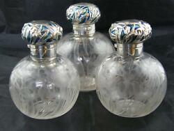 SET OF 3 INTAGLIO CUT GLASS SCENT BOTTLES 1904 HM SILVER AND ENAMELLED LIDS