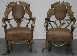 ANTIQUE PAIR BLACK FOREST ANTLER LEATHER ARM CHAIRS: FALLOW AND RED DEER ANTLERS