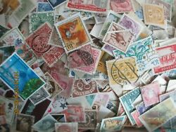 500 World Wide Collection Stamps Off Paper.