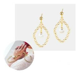 Fascinating oval braided gold tone white simulated pearl dangle earrings