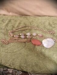 Stunning necklace with gold tone chain & clay tone & gray stones with tassel.